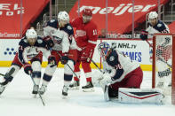 Columbus Blue Jackets goaltender Joonas Korpisalo (70) stops a Detroit Red Wings right wing Filip Zadina (11) shot in the second period of an NHL hockey game Monday, Jan. 18, 2021, in Detroit. (AP Photo/Paul Sancya)
