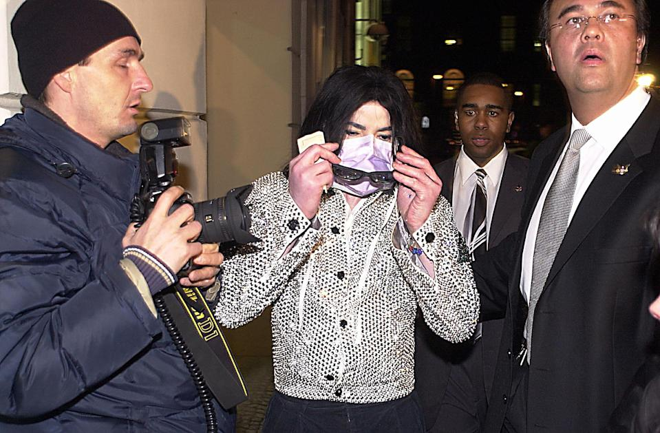 Michael Jackson, shown in 2002, wore disguises in an effort to avoid the paparazzi. (Photo: Eric Richard/Getty Images)
