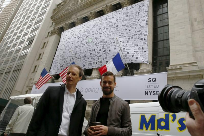 Jack Dorsey, CEO of Square and CEO of Twitter, poses as he arrives at the New York Stock Exchange