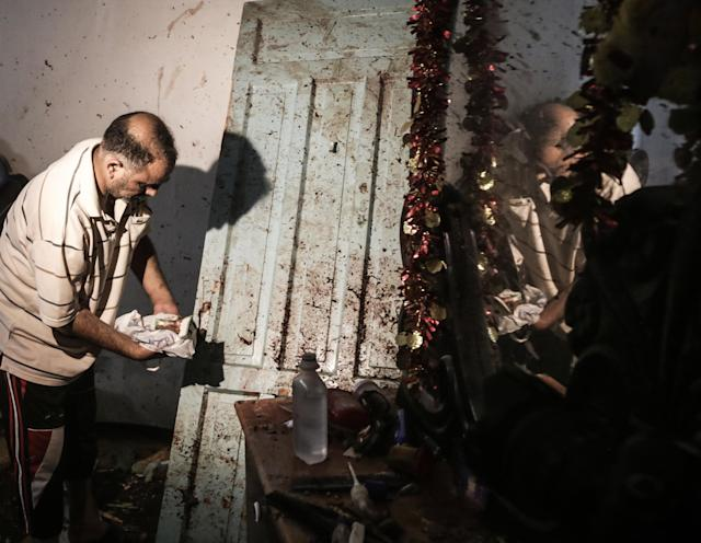 <p>A man cleans bloodstains inside a damaged house where a Palestinian woman and her 18-month old child were killed following an Israeli airstrike in the central Gaza Strip on Aug. 9, 2018. (Photo: Nidal ALwaheidi/SOPA Images/LightRocket via Getty Images) </p>