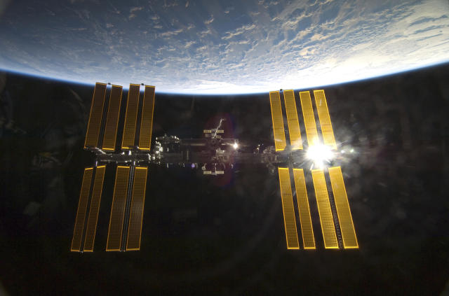 With the Earth in the background, the International Space Station is featured in this image photographed by an STS-130 crew member from aboard the Space Shuttle Endeavour in this photo released by NASA and taken February 9, 2010. REUTERS/NASA Handout (UNITED STATES - Tags: SCI TECH IMAGES OF THE DAY) FOR EDITORIAL USE ONLY. NOT FOR SALE FOR MARKETING OR ADVERTISING CAMPAIGNS