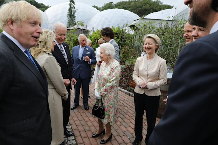ST AUSTELL, ENGLAND - JUNE 11: British Prime Minister Boris Johnson (L) is seen next to United States President Joe Biden (3L) and First Lady Jill Biden (2L) as they speak to Queen Elizabeth II as President of the European Commission Ursula von der Leyen looks on as he hosts a drinks reception for Queen Elizabeth II and G7 leaders at The Eden Project during the G7 Summit on June 11, 2021 in St Austell, Cornwall, England. UK Prime Minister, Boris Johnson, hosts leaders from the USA, Japan, Germany, France, Italy and Canada at the G7 Summit. This year the UK has invited India, South Africa, and South Korea to attend the Leaders' Summit as guest countries as well as the EU. (Photo by Jack Hill - WPA Pool / Getty Images)