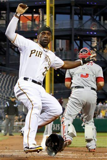 Pittsburgh Pirates' Andrew McCutchen, left, scores past Washington Nationals catcher Wilson Ramos during the third inning of a baseball game in Pittsburgh on Wednesday, May 9, 2012. McCutchen scored from third on a ground ball by Casey McGhee to Nationals shortstop Ian Desmond. (AP Photo/Gene J. Puskar)