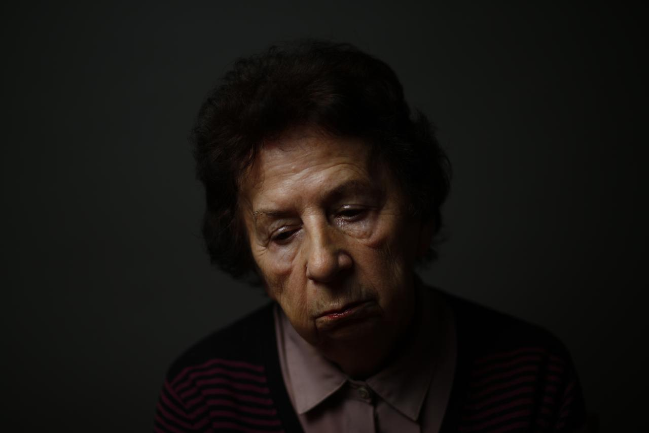 Auschwitz death camp survivor Barbara Doniecka, 80, who was registered with camp number 86341, poses for a photo in Warsaw January 12, 2015. Doniecka was 12-years-old during the Warsaw Uprising when she was sent to Auschwitz-Birkenau with her mother. As the liberation of Auschwitz approaches its 70th anniversary this month, Reuters photographers took portraits of now elderly survivors. About 1.5 million people, most of them Jews, were killed at the Nazi camp which has became a symbol of the horrors of the Holocaust and World War Two, which ravaged Europe. The camp was liberated by Soviet Red Army troops on January 27, 1945 and about 200,000 camp inmates survived. REUTERS/Kacper Pempel (POLAND - Tags: ANNIVERSARY SOCIETY PORTRAIT CONFLICT)