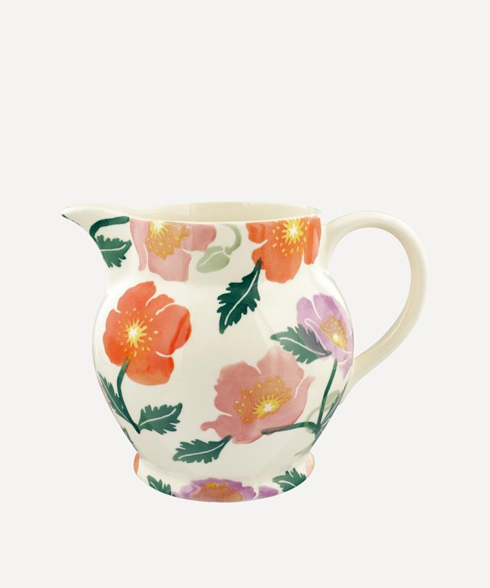 """Designed by Emma Bridgewater and made in Stoke-on-Trent in the U.K., this ceramic pitcher has an extra-wide mouth that makes filling it with <a href=""""https://www.architecturaldigest.com/gallery/best-online-flower-delivery?mbid=synd_yahoo_rss"""" rel=""""nofollow noopener"""" target=""""_blank"""" data-ylk=""""slk:fresh flowers"""" class=""""link rapid-noclick-resp"""">fresh flowers</a> a breeze. $130, Liberty of London. <a href=""""https://www.libertylondon.com/us/bright-poppies-six-pint-jug-000723618.html#pos=23"""" rel=""""nofollow noopener"""" target=""""_blank"""" data-ylk=""""slk:Get it now!"""" class=""""link rapid-noclick-resp"""">Get it now!</a>"""