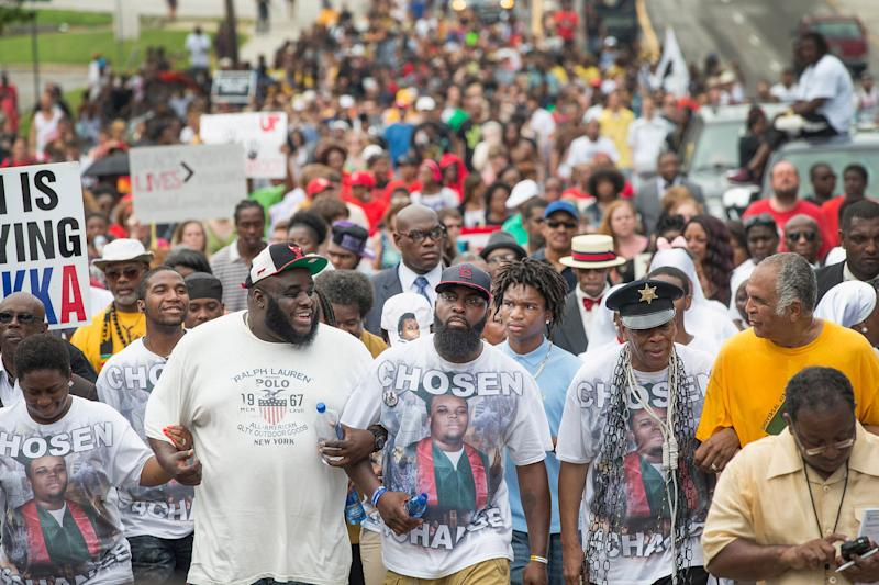 Michael Brown Sr. (center) leads a march from the location where his son Michael Brown Jr. was shot and killed following a memorial service marking the anniversary of his death in Ferguson, Mo. on Aug. 9, 2015. | Scott Olson—Getty Images