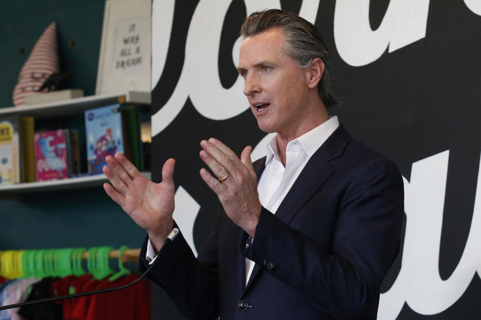 "FILE - In this Tuesday, May 5, 2020, file photo California Gov. Gavin Newsom discusses his plan for the gradual reopening of California businesses during a news conference at the Display California store in Sacramento, Calif. Gov. Newsom said he could have communicated better with the public last year before the first loosening of coronavirus restrictions that led to an early summer spike in case, a moment the called a ""gateway that we reflect upon all the time"" as the nation's most populous state enters the second year of pandemic restrictions. (AP Photo/Rich Pedroncelli, Pool,File)"