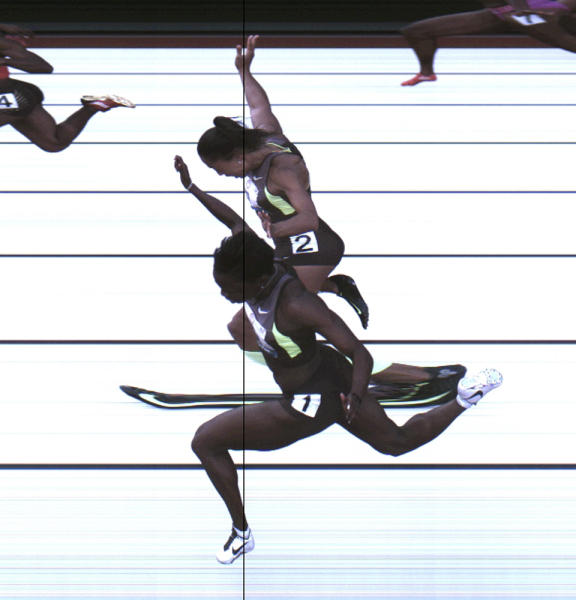 This Saturday, June 23, 2012, photo provided by USA Track & Field shows the third-place finish of the women's 100-meter final from a photo-finish camera, shot at 3,000-frames-per-second, during the U.S. Olympic Track and Field Trials in Eugene, Ore. Allyson Felix and Jeneba Tarmoh, in foreground, finished in a dead heat for the last U.S. spot in the 100 to the London Games, each leaning across the finish line in 11.068 seconds. (AP Photo/USA Track & Field)