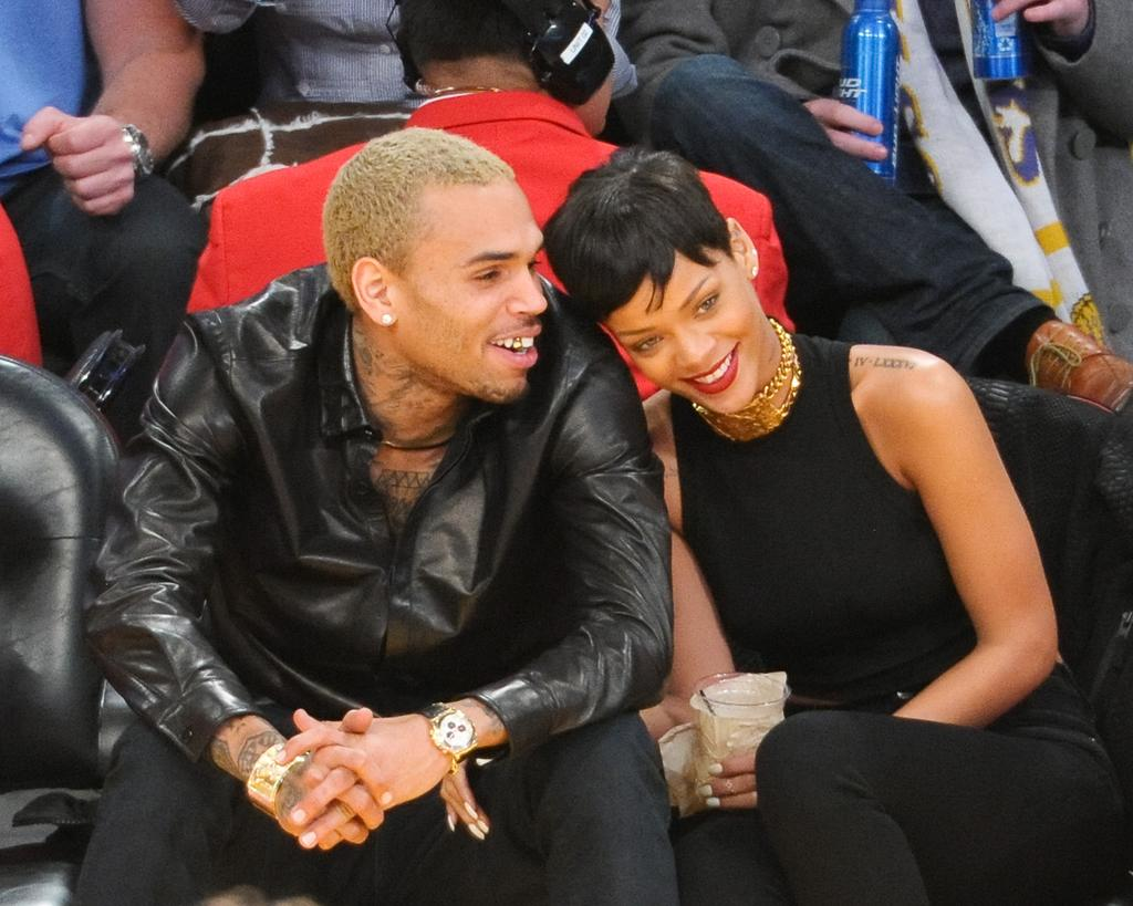 LOS ANGELES, CA - DECEMBER 25:  Chris Brown (L) and Rihanna attend a basketball game between the New York Knicks and the Los Angeles Lakers at Staples Center on December 25, 2012 in Los Angeles, California.  (Photo by Noel Vasquez/Getty Images)