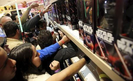 """FILE PHOTO - Customers pick new toys from the upcoming film """"Star Wars: The Force Awakens"""" on """"Force Friday"""" in Sao Paulo, Brazil, September 4, 2015.  REUTERS/Paulo Whitaker/File Photo"""