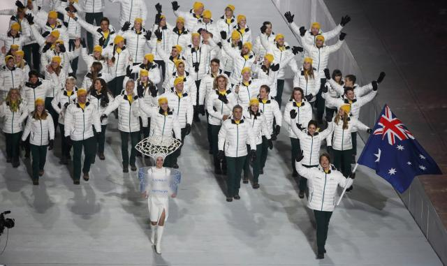 Australia's flag-bearer Alex Pullin leads his country's contingent during the opening ceremony of the 2014 Sochi Winter Olympics, February 7, 2014. REUTERS/Lucy Nicholson (RUSSIA - Tags: OLYMPICS SPORT)