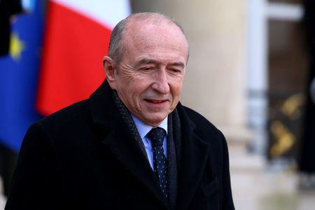 French Interior Minister Gerard Collomb leaves the Elysee Palace following the weekly cabinet meeting in Paris, France, February 21, 2018.  REUTERS/Stephane Mahe