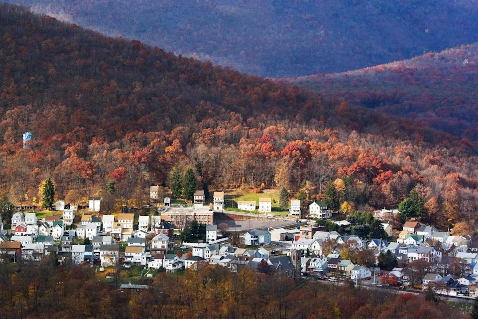 """<p>Those rolling hills? That charming architecture? There's a reason <a href=""""https://www.tripadvisor.com/Tourism-g52905-Jim_Thorpe_Pocono_Mountains_Region_Pennsylvania-Vacations.html"""" rel=""""nofollow noopener"""" target=""""_blank"""" data-ylk=""""slk:this town"""" class=""""link rapid-noclick-resp"""">this town</a> is known as the """"Switzerland of Pennsylvania."""" Come here if you want to try your hand at white water rafting or hike the day away, then roam the quaint town afterward. </p>"""