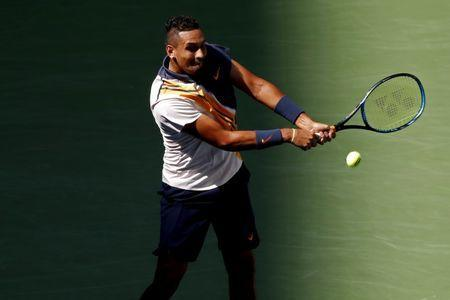 Sep 1, 2018; New York, NY, USA; Nick Kyrgios of Australia hits a backhand against Roger Federer of Switzerland (not pictured) in the third round on day six of the US Open at USTA Billie Jean King National Tennis Center. Mandatory Credit: Geoff Burke-USA TODAY Sports