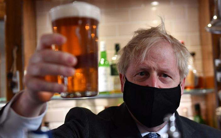 Cheers to climate action: Boris Johnson will speed up the UK's carbon emission targets - Getty