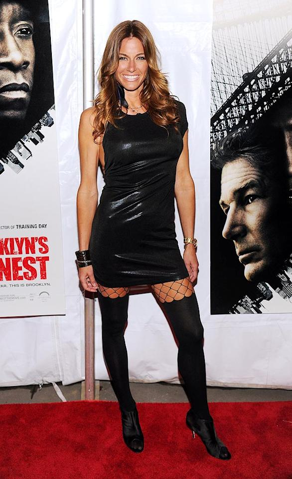 """The Real Housewives of New York City"" star Kelly Bensimon looks great ... until you get to the three inches of fishnet between her dress and her opaque tights. Those three inches lost you the prize, honey. Dimitrios Kambouris/<a href=""http://www.wireimage.com"" target=""new"">WireImage.com</a> - March 2, 2010"