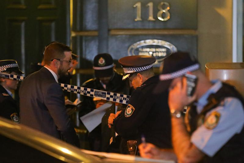 NSW Police are seen outside of an apartment building on Clarence Street after a woman's body was found.