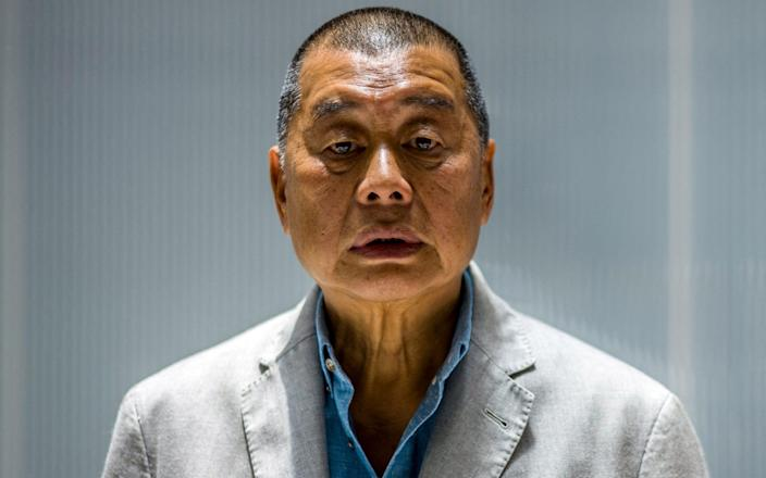 In this file photo taken on June 16, 2020, millionaire media tycoon Jimmy Lai, 72, poses during an interview with AFP at the Next Digital offices in Hong Kong. - Lai was jailed for 12 months on April 16, 2021 over one of the city's biggest ever protests in 2019. - Anthony Wallace/AFP