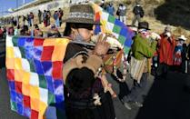 """Bolivian demonstrators blew large sea shell horns known as """"pututus"""" during a march against the government of interim President Jeanine Anez"""