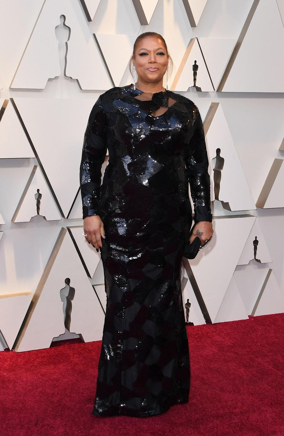 <p>Wearing a sequined dress, Chopard jewels, and Jimmy Choo shoes.</p>