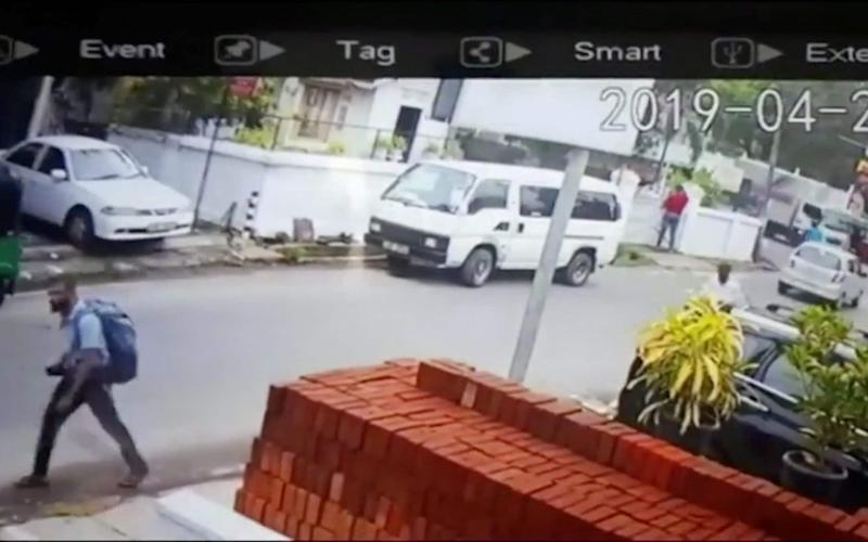 A suspected suicide bomber carries a backpack on a street in Negombo, Sri Lanka, in this still image taken from a CCTV handout footage of Easter Sunday attacks - REUTERS