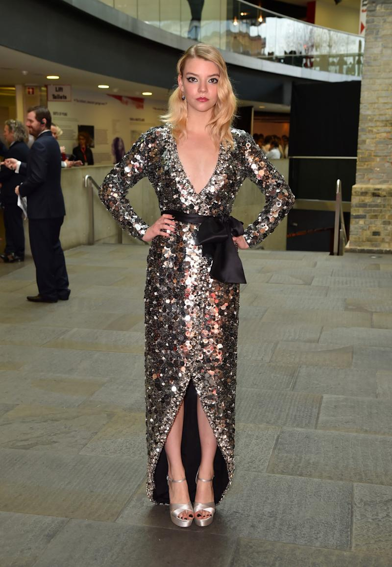 Anya is proving to be a real style star in a low-cut sequinned Miu Miu gown.<br /><i>[Photo: PA]</i>