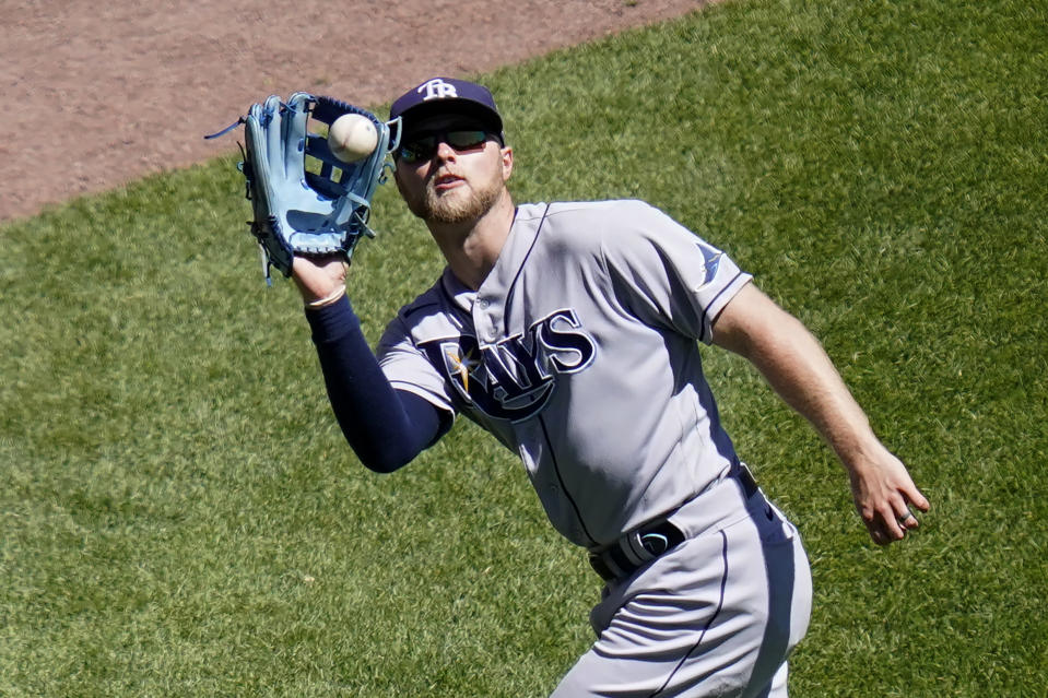 Tampa Bay Rays' Austin Meadows catches a deep fly ball from Chicago White Sox's Zack Collins during the sixth inning of a baseball game Wednesday, June 16, 2021, in Chicago. (AP Photo/Charles Rex Arbogast)