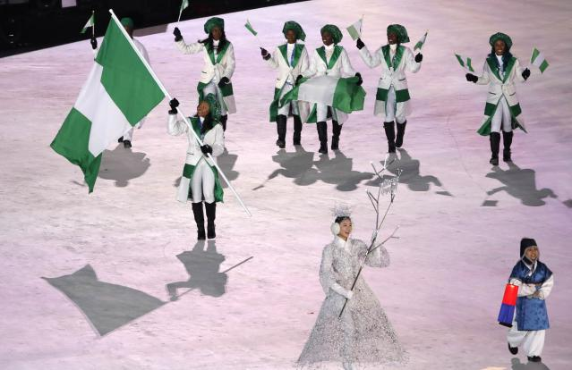 <p>Pyeongchang 2018 Winter Olympics – Opening ceremony – Pyeongchang Olympic Stadium – Pyeongchang, South Korea – February 9, 2018 – Ngozi Onwumere of Nigeria carries the national flag during the opening ceremony. REUTERS/Kim Kyung-Hoon </p>