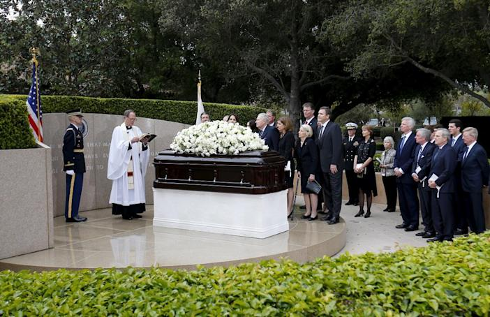 <p>The Rev. Stuart A. Kenworthy, vicar of Washington National Cathedral, speaks as family and friends gather during the funeral for Nancy Reagan on March 11, 2016. <i> (Photo: Mike Blake/Reuters)</i></p>
