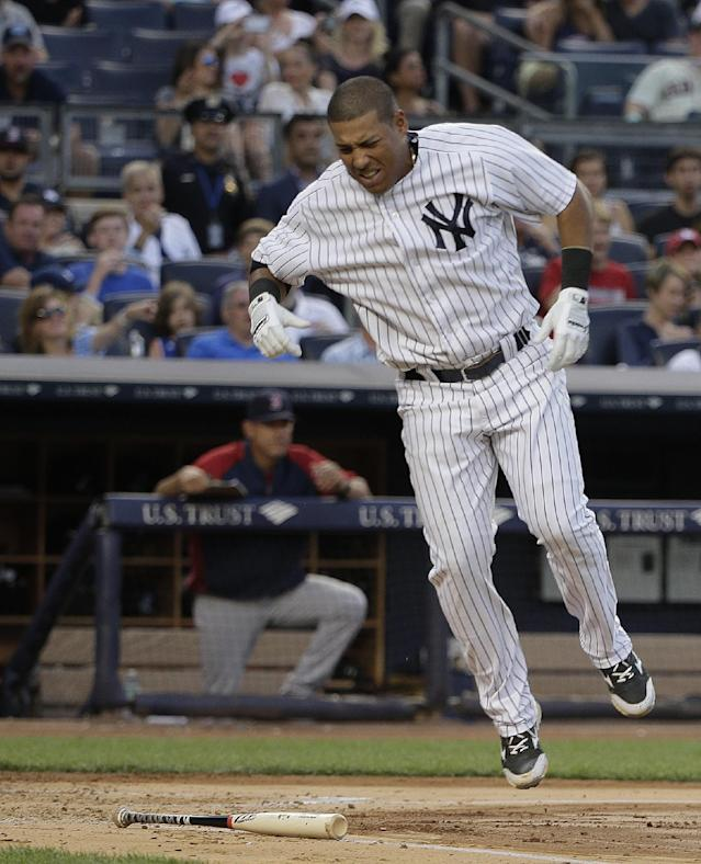 New York Yankees' Yangervis Solarte reacts after being hit on the foot with a Boston Red Sox pitch durng the third inning of a baseball game, Saturday, June 28, 2014, in New York. (AP Photo/Julie Jacobson)