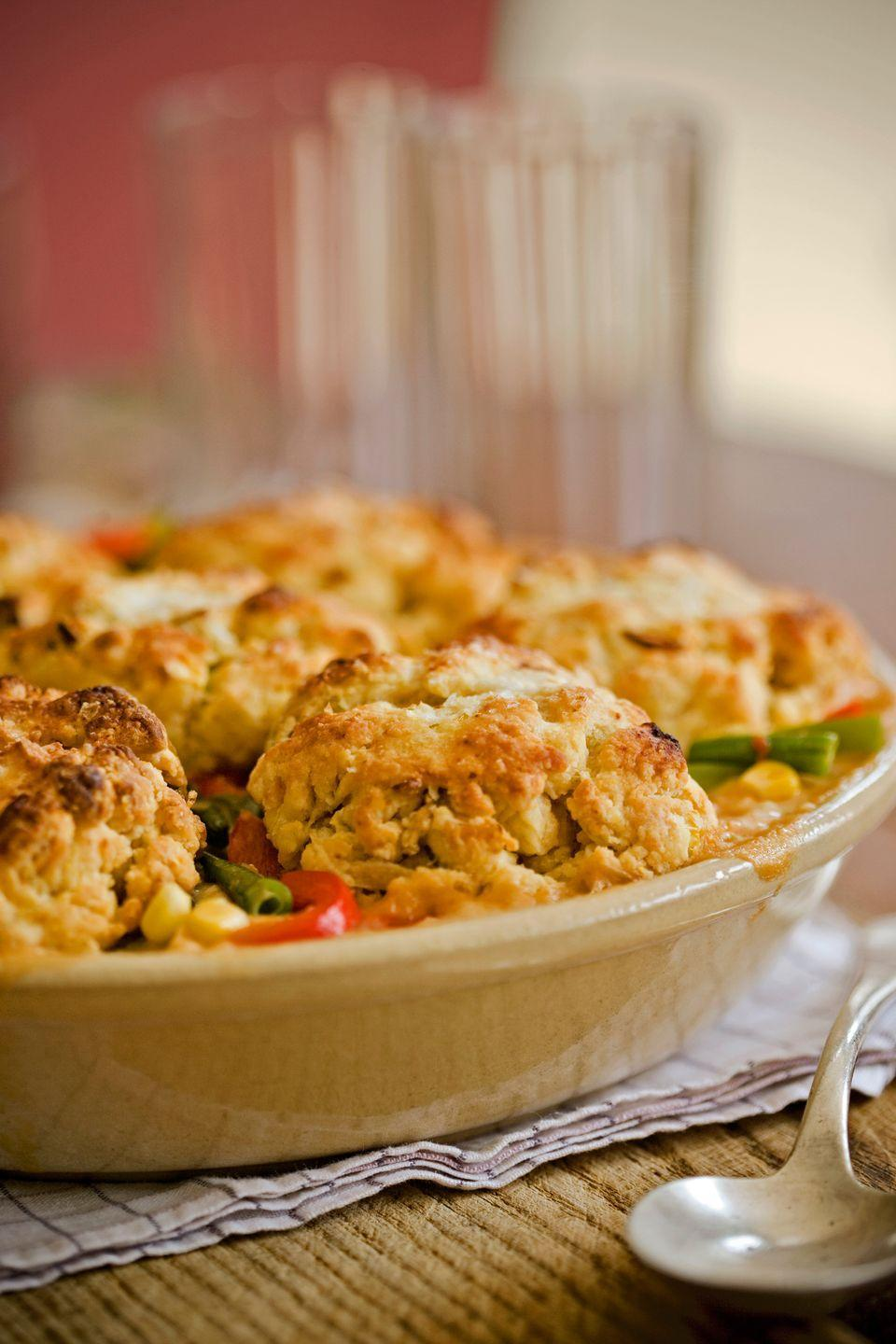 """<p>Quick homemade biscuits top this turkey cobbler, which owes some of its smoky flavor to chipotle peppers in adobo sauce. </p><p><strong><a href=""""https://www.countryliving.com/food-drinks/recipes/a2370/smoked-turkey-cobbler-recipe/"""" rel=""""nofollow noopener"""" target=""""_blank"""" data-ylk=""""slk:Get the recipe"""" class=""""link rapid-noclick-resp"""">Get the recipe</a>.</strong></p>"""
