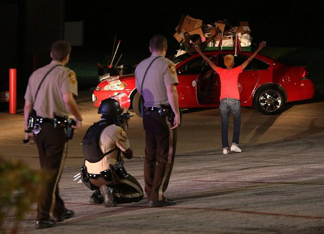 <p>St. Louis County and Dellwood police detain two people on Wednesday, August 13, 2014 in Ferguson, Missouri. Both people were released after being questioned. (Chris Lee/St. Louis Post-Distpatch//TNS/ZUMA Wire) </p>