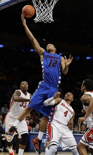 DePaul's Cleveland Melvin (12) drives past Rutgers' Wally Judge (33) and Myles Mack (4) during the second half of an NCAA college basketball game at the Big East Conference tournament, Tuesday, March 12, 2013, in New York. (AP Photo/Frank Franklin II)