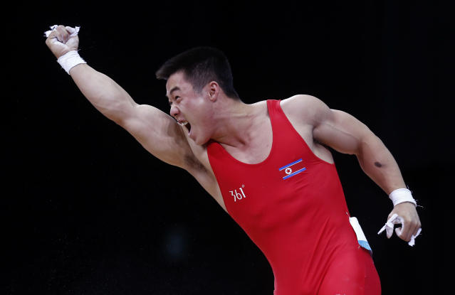 North Korea's Un Guk Kim reacts after successful lift on the men's 62Kg Group A weightlifting competition at the London 2012 Olympic Games July 30, 2012. REUTERS/Dominic Ebenbichler (BRITAIN - Tags: SPORT OLYMPICS SPORT WEIGHTLIFTING)
