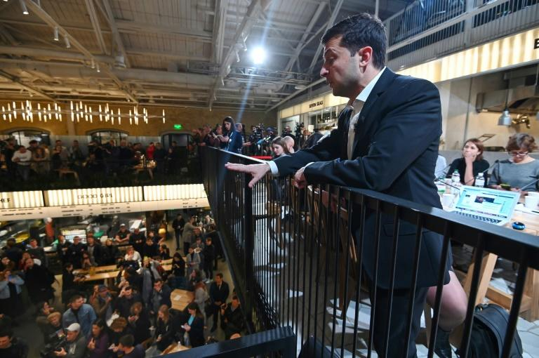 Ukrainian President Volodymyr Zelensky talks to the crowd at a food court in Kiev during his day-long media marathon