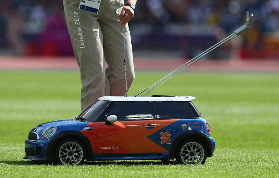 LONDON, ENGLAND - AUGUST 08:  A remote control Mini car is used to return the hammer in the Women's Hammer Throw Qualifications on Day 12 of the London 2012 Olympic Games at Olympic Stadium on August 8, 2012 in London, England.  (Photo by Michael Steele/Getty Images)