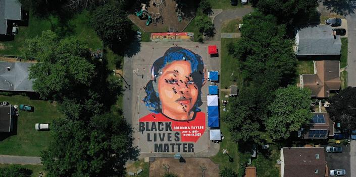 An aerial view from a drone shows a large-scale ground mural depicting Breonna Taylor in Maryland.