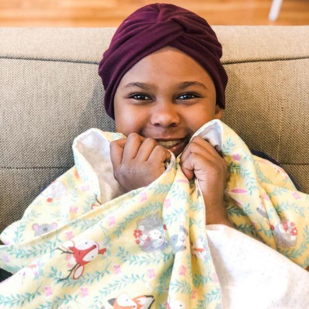 PHOTO: Hazel Kindred, 10, cuddles up in her blanket from Lucy Blaylock. (Larissa Kindred)