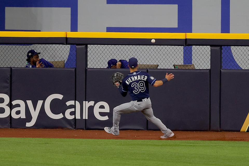 ARLINGTON, TEXAS - OCTOBER 20:  Kevin Kiermaier #39 of the Tampa Bay Rays fields a double off the wall hit by Justin Turner (not pictured) of the Los Angeles Dodgers during the sixth inning in Game One of the 2020 MLB World Series at Globe Life Field on October 20, 2020 in Arlington, Texas. (Photo by Ronald Martinez/Getty Images)