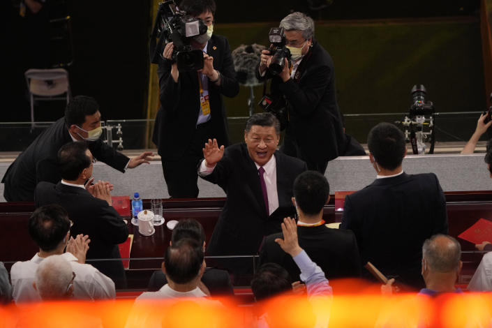 FILE - In this June 28, 2021, file photo, Chinese President Xi Jinping waves as he attends a gala show ahead of the 100th anniversary of the founding of the Chinese Communist Party in Beijing. An avalanche of changes launched by China's ruling Communist Party has jolted everyone from tech billionaires to school kids. Behind them: Xi's vision of reviving an idealized early era of vigorous party leadership, with more economic equality and tighter control over society and billionaire entrepreneurs. (AP Photo/Ng Han Guan, File)