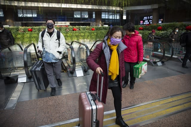 Commuters take precautions at Beijing West Railway Station