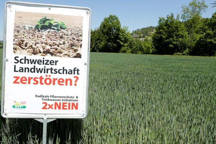 FILE PHOTO: A poster is placed in front of a field near Aesch