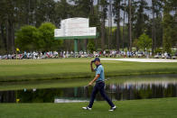 Justin Thomas acknowledges the gallery as he walks to the 15th green during the second round of the Masters golf tournament on Friday, April 9, 2021, in Augusta, Ga. (AP Photo/David J. Phillip)