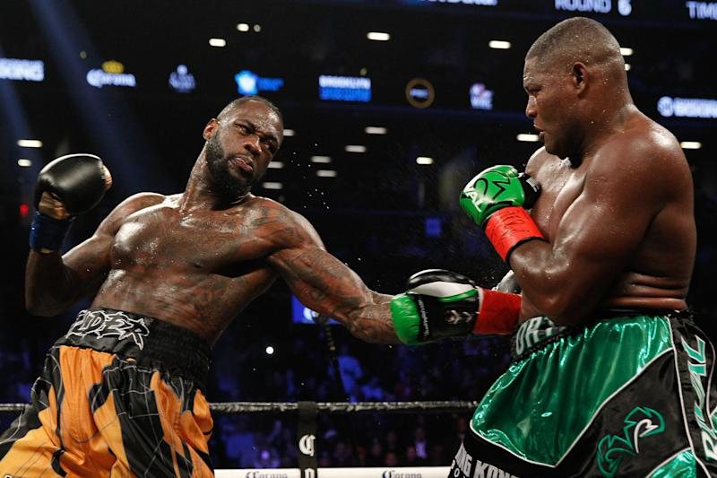 BROOKLYN, NY - MARCH 03: Deontay Wilder (gold/black) defeated Luis Ortiz (green/black) ON MARCH 3, 2018, at the Barclays Center in Brooklyn, NY. (Photo by Edward Diller/Icon Sportswire via Getty Images)