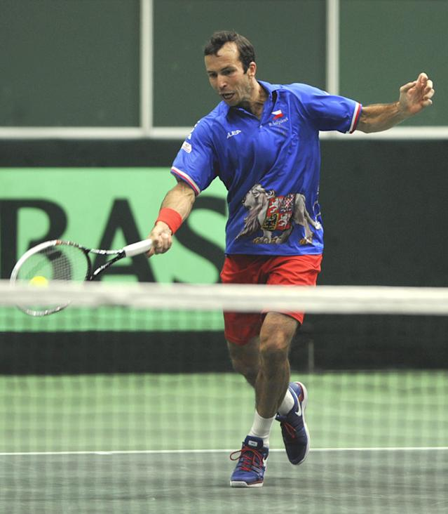 Radek Stepanek from the Czech Republic returns during his Davis Cup first round doubles match with Tomas Berdych against Robin Haase and Jean-Julien Rojer from the Netherlands in Ostrava, Czech Republic, Saturday, Feb. 1, 2014. (AP Photo,CTK/Jaroslav Ozana)