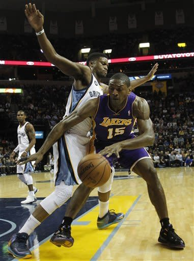Memphis Grizzlies forward Rudy Gay, front left, pressures Los Angeles Lakers forward Metta World Peace (15) in the first half of an NBA basketball game on Friday, Nov. 23, 2012, in Memphis, Tenn. (AP Photo/Lance Murphey)