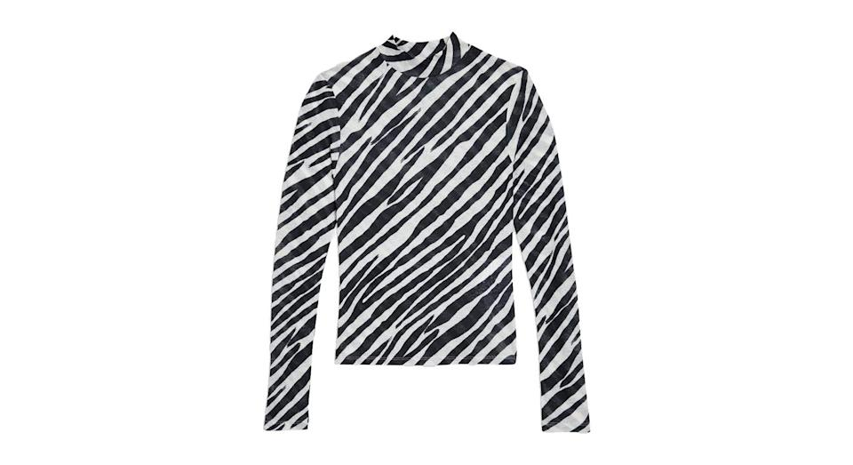 "<p>Zebra print is the new leopard print this season, so why not test the waters with a chic roll neck worn under your fave jacket? <br><a href=""http://www.topshop.com/en/tsuk/product/zebra-print-long-sleeve-top-7910510?Ntt=zebra"" rel=""nofollow noopener"" target=""_blank"" data-ylk=""slk:Buy here."" class=""link rapid-noclick-resp"">Buy here. </a> </p>"