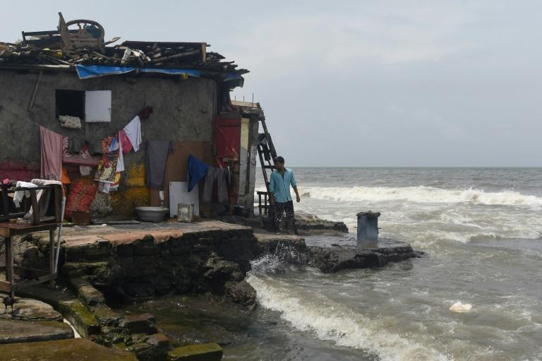 The shore has retreated by more than 20 metres at some Mumbai beaches over the past 15 years (AFP Photo/PUNIT PARANJPE)