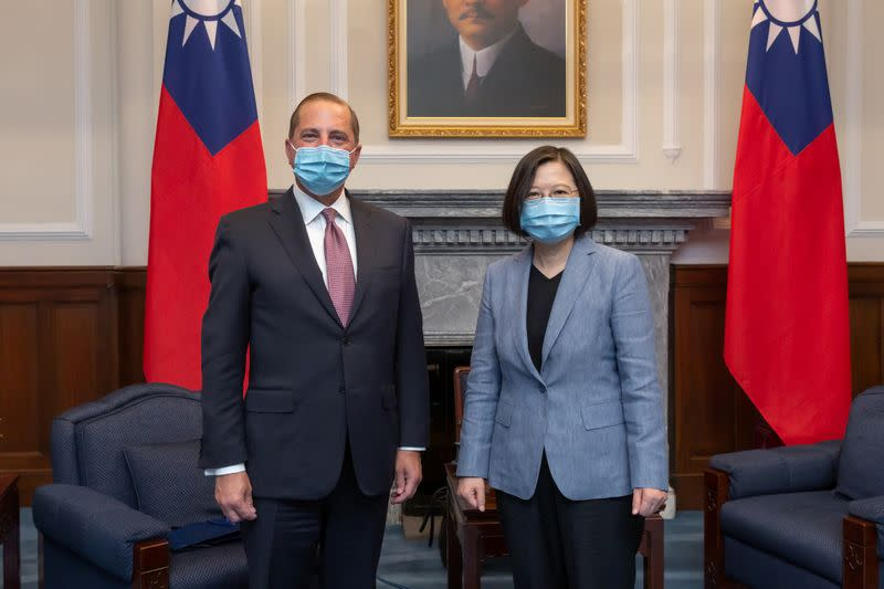 U.S. Secretary of Health and Human Services Alex Azar and Taiwan President Tsai Ing-wen, both wearing face masks, pose for photos during their meeting at the presidential office, in Taipei
