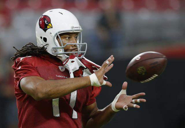 Arizona Cardinals wide receiver Larry Fitzgerald reaches out to make a catch during an NFL football practice Thursday, Aug. 9, 2018, in Glendale, Ariz. (AP Photo/Ross D. Franklin)